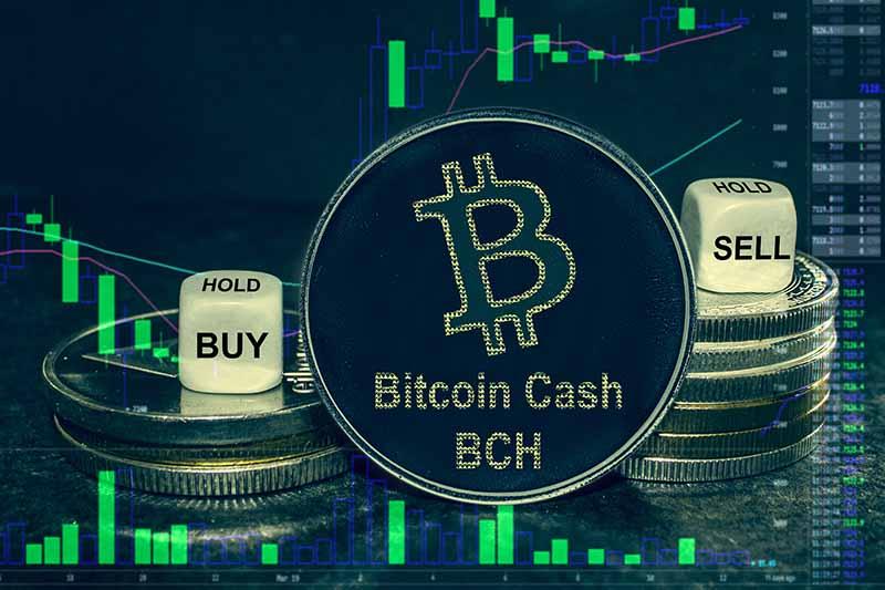 une illustration de bitcoin cash avec des dés de vente et d'achat